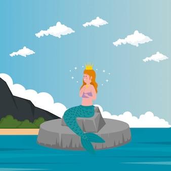 Sirena sentada en piedra con mar