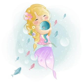 Sirenita encantadora sosteniendo un caballito de mar