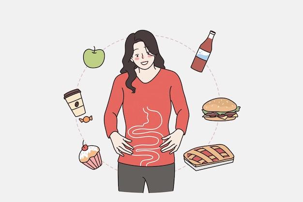 Sistema gastro y concepto de digestión saludable. joven sonriente personaje de dibujos animados de mujer de pie mostrando su digestión con varios alimentos volando alrededor de ilustración vectorial