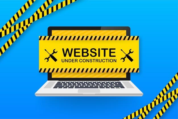Sitio web en construcción firmar en la computadora portátil.