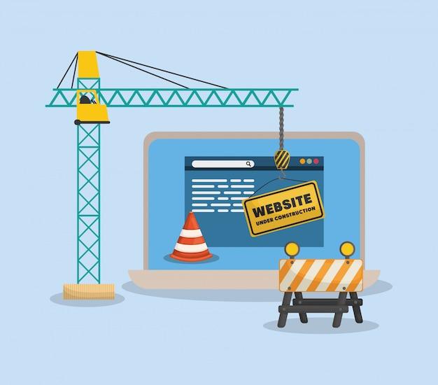 Sitio web en construcción con laptop