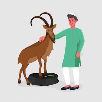 Smiley muslim young boy que sostiene la hierba con la cabra marrón en fondo gris.