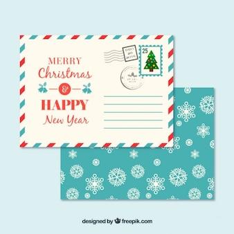 Sobre de copos de nieve y postal navideña