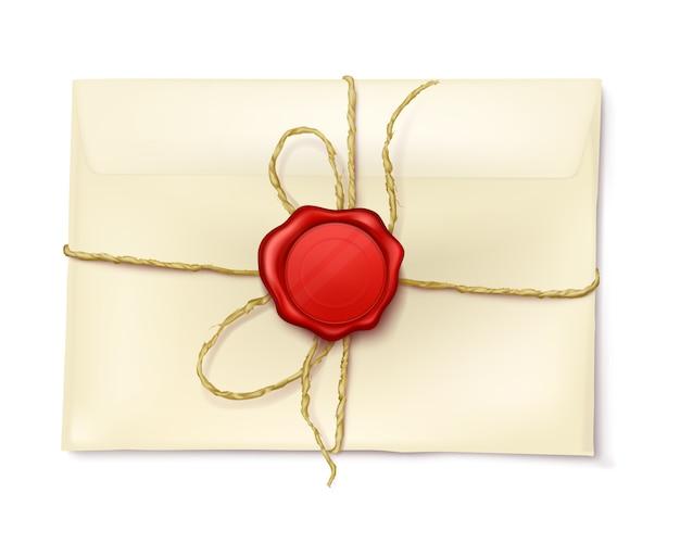 Sobre de papel con sello de cera roja.