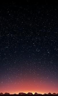 Sol naciente detrás de montañas y cielo estrellado
