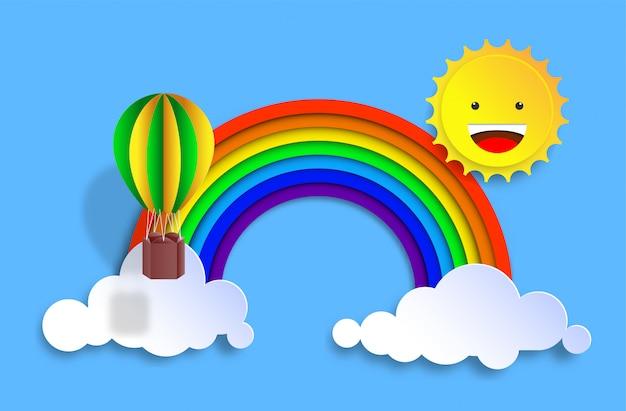 Sol sonriente en arco iris y globos de aire caliente en la nube con estilo de corte de papel