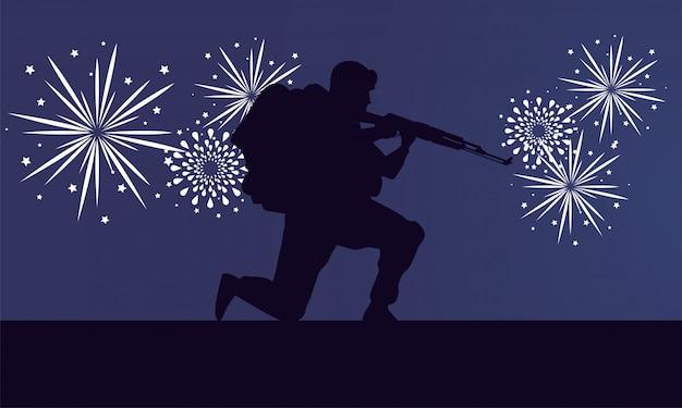 Soldado con silueta de figura de rifle y fuegos artificiales