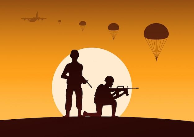 Soldado sostener arma otro listo para disparar, paracaidista abajo