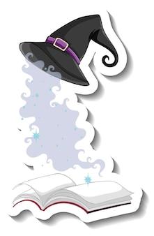 Sombrero de bruja y un libro sobre fondo blanco.
