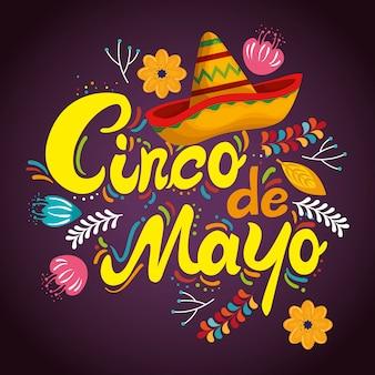 Sombrero mexicano con flores para la celebración del evento.