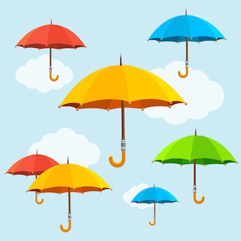 Sombrillas de colores vuelan en el cielo. diseño plano