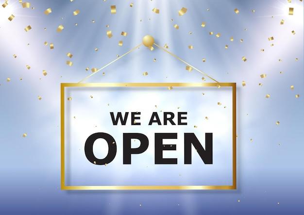 Somos letrero abierto con confeti dorado y focos.