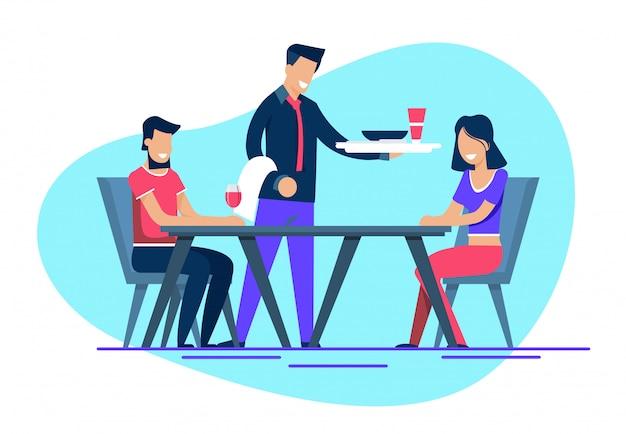 Sonriente hombre y mujer en citas en el restaurante