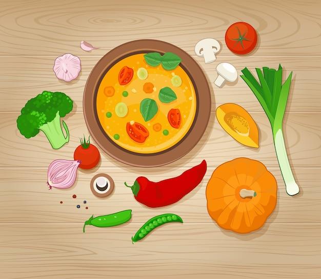 Sopa de verduras e ingredientes sobre fondo de madera