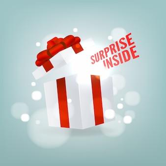 Sorpresa dentro de una caja de regalo abierta