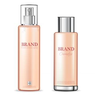Spray rosa de botellas de cosmética.