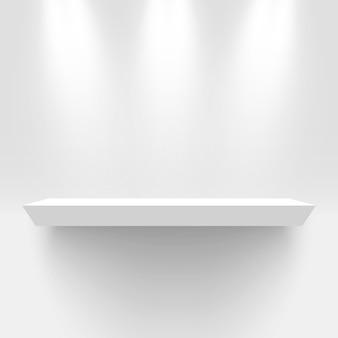 Stand de exposición blanco, iluminado por focos