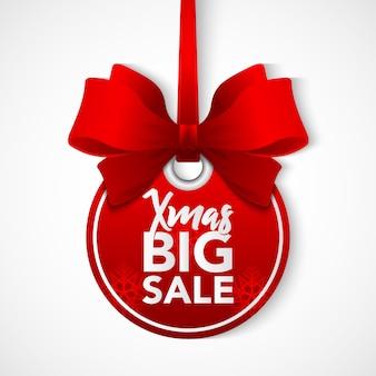 Stock venta de bolas de navidad con cinta roja.