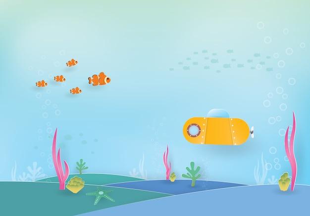 Submarino bajo el mar con pez payaso payaso