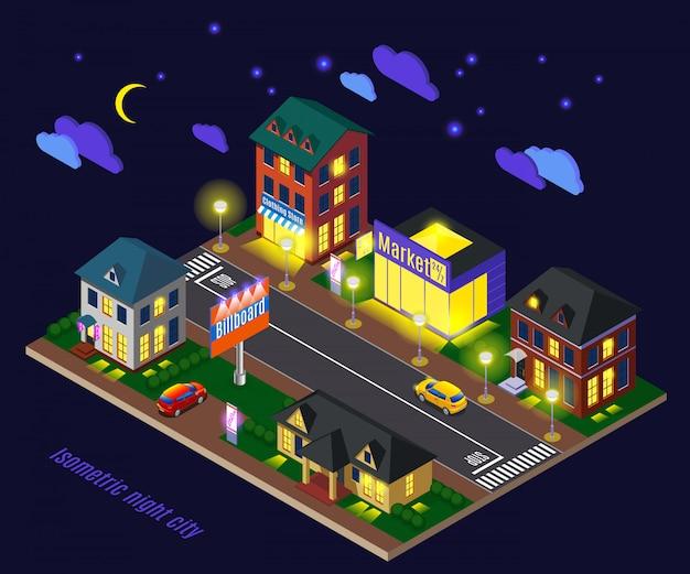 Suburbio con casas luminosas en la noche.