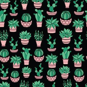 Suculentas negras y cactus en macetas.