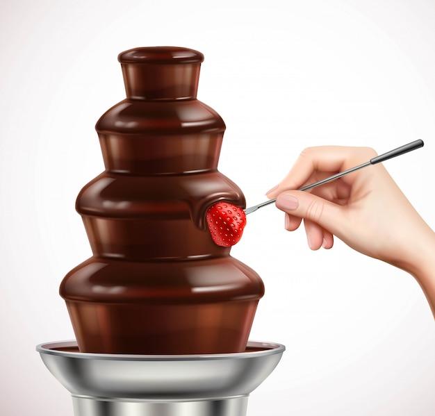 Sumergir la fresa en la composición de la fuente de chocolate