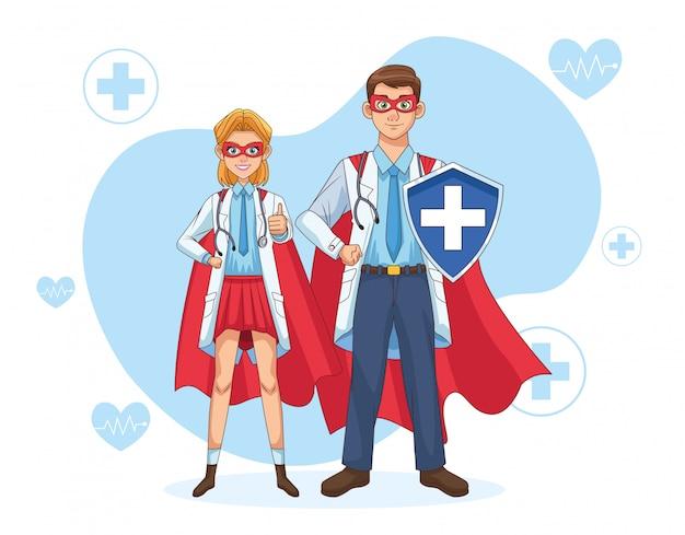 Super doctores pareja con capa de héroe y escudo
