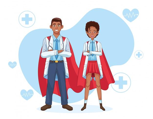 Super doctores pareja con capa de héroe