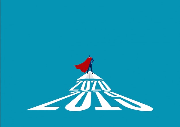 Superhéroe empresario de pie sobre papel cohete. el concepto de éxito, liderazgo y victoria en los negocios.