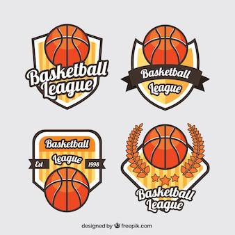 Surtido de cuatro logos de baloncesto en diseño plano