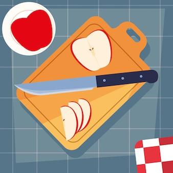 Tabla de cocina con manzanas y cuchillo