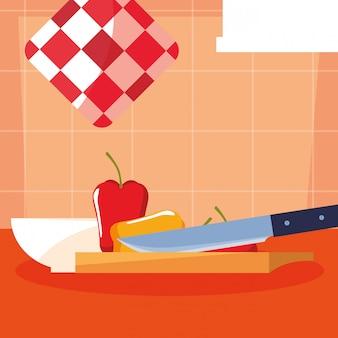Tabla de cocina con pimentón y cuchillo.