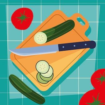 Tabla de cocina con verduras y cuchillo.