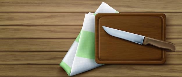 Tabla de cortar, cuchillo y mantel en la vista superior de la mesa de cocina de madera, ilustración realista en d, de un tablón de madera rectangular para cortar alimentos, cuchillo de acero y mantel doblado
