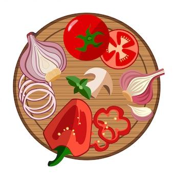 Tabla de cortar y verduras de colores.