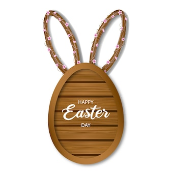 Tabla de madera con forma de huevo de pascua con orejas de conejo