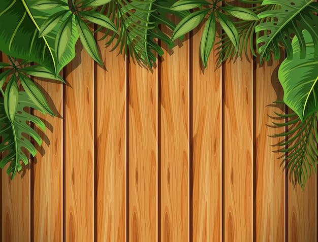 Tablero de madera con hojas verdes en la parte superior