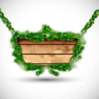 Tablero de madera con ramas de abeto