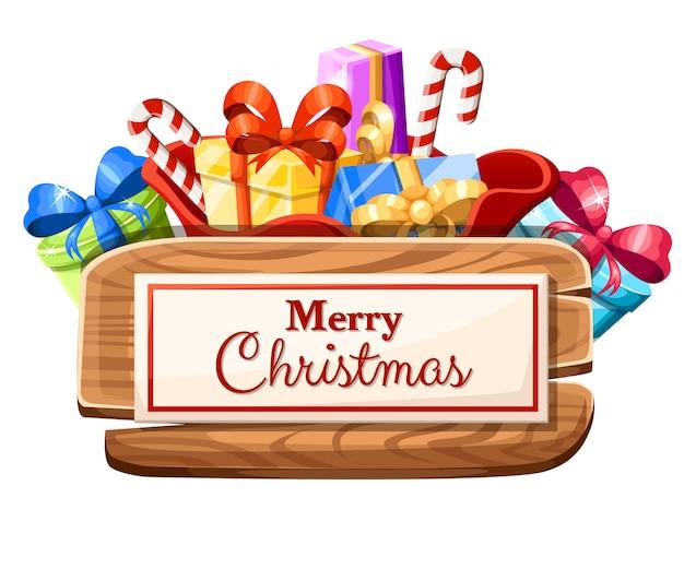 Tablero de navidad de madera con juego de regalos y la inscripción con la ilustración feliz navidad sobre fondo blanco.