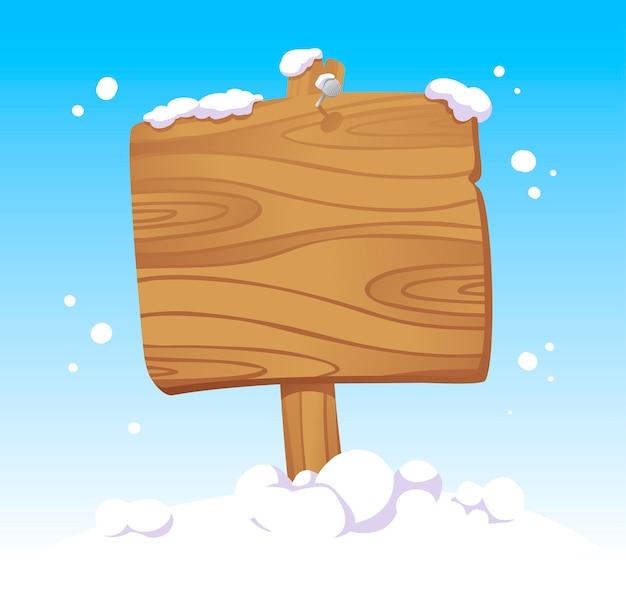 Tablero de navidad de madera en la nieve.