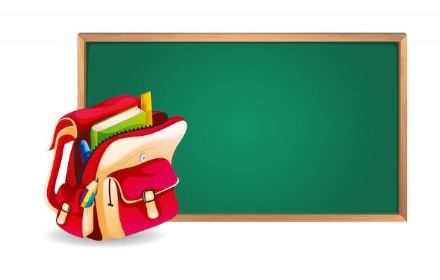 Tablero verde y mochila escolar