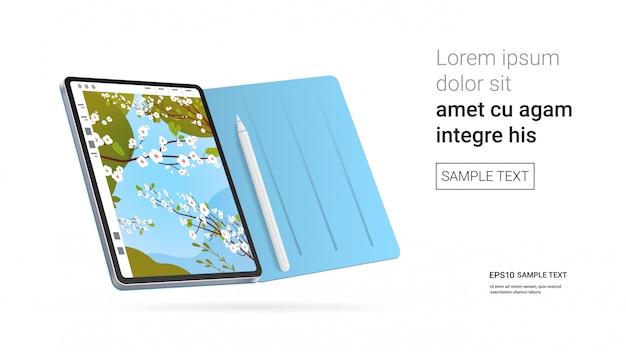 Tableta con hermoso fondo de pantalla en la pantalla aislada en la pared blanca dispositivos y dispositivos de maquetas realistas