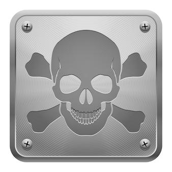 Tableta de metal con calavera y huesos cruzados.