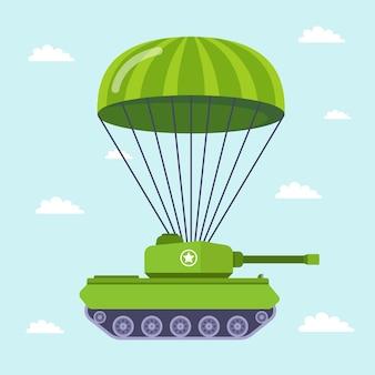 Tanque vuela en paracaídas en el campo de batalla.