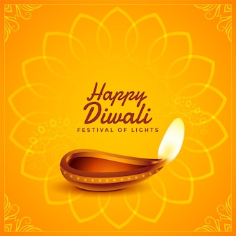 Tarjeta amarilla decorativa feliz diwali con diya realista