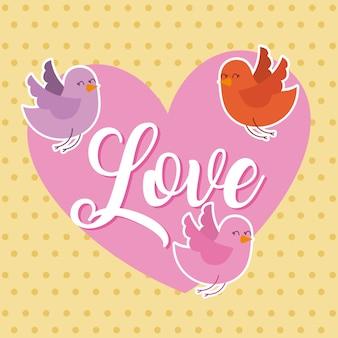 Tarjeta de amor corazón rosa y pájaros volando
