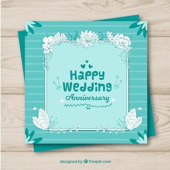 Tarjeta de aniversario de boda con flores