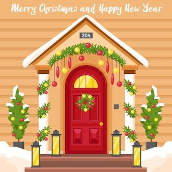 Tarjeta de año nuevo con casa decorada para navidad