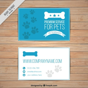 Tarjeta azul de mascotas con huellas y hueso