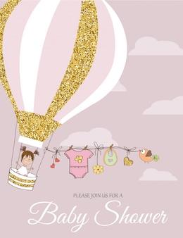 Tarjeta de baby shower con detalles dorados brillantes